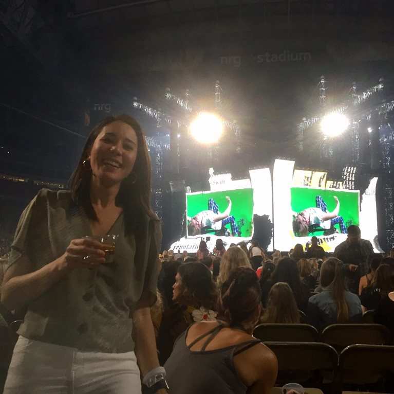 Mim at a concert with big tv screen