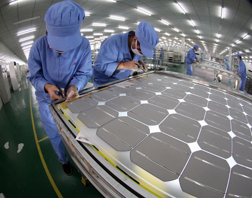 Workers produce solar-cell modules in a factory in China's Jiangsu Province.